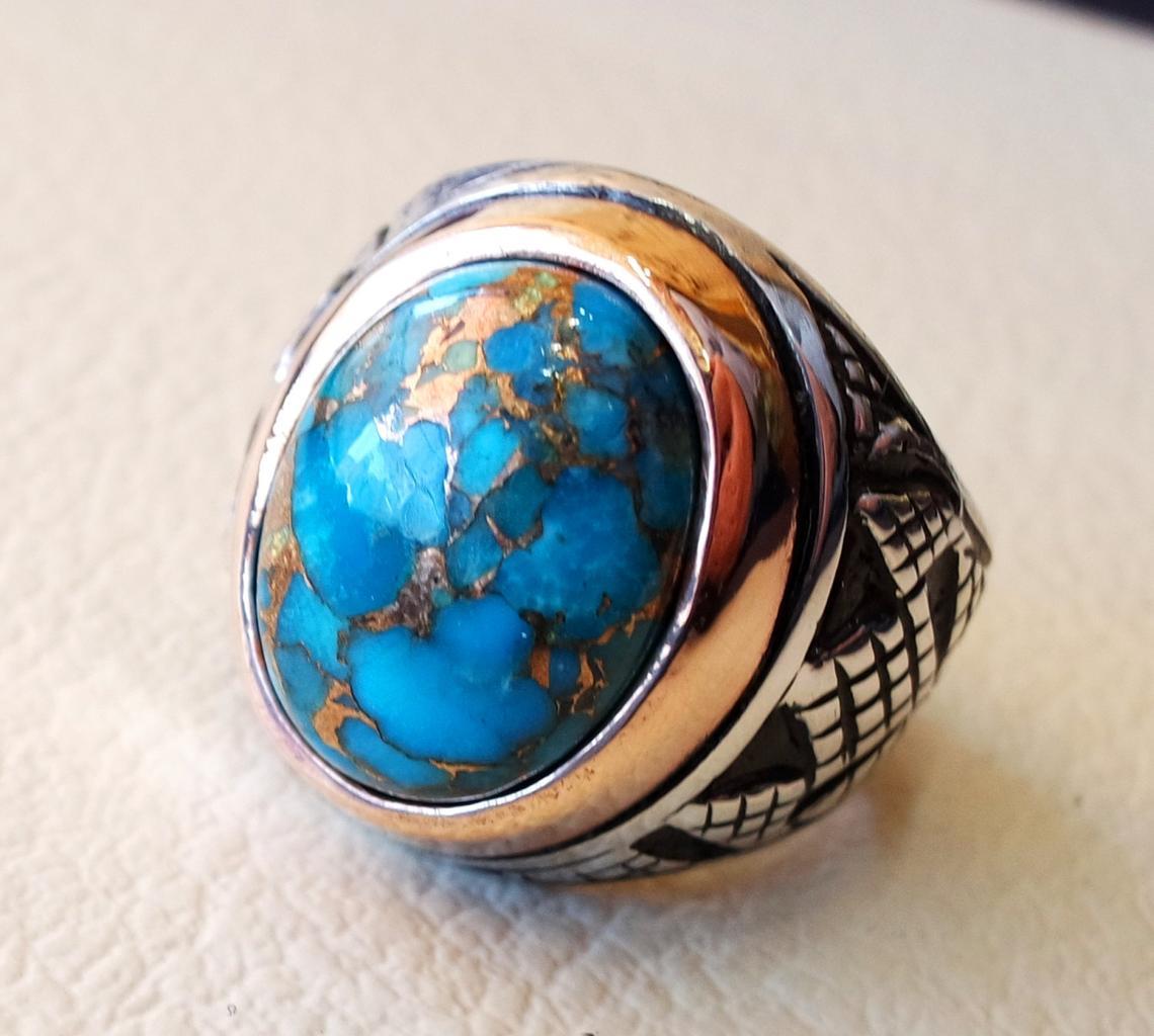 خاتم فيروز أزرق ذو تصميم مميز